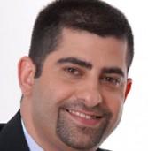מנהל סניף חיפה של קומסיין