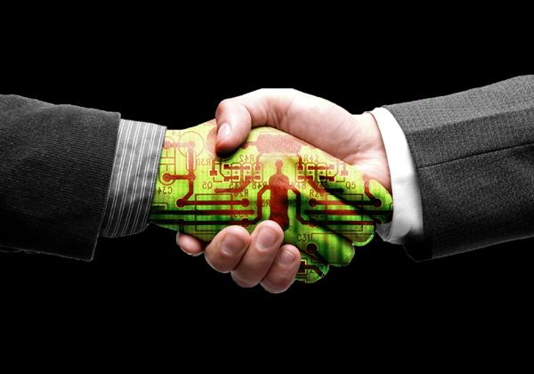 אתגרי העתיד: לוחצים ידיים לטכנולוגיה. אילוסטרציה: BigStock