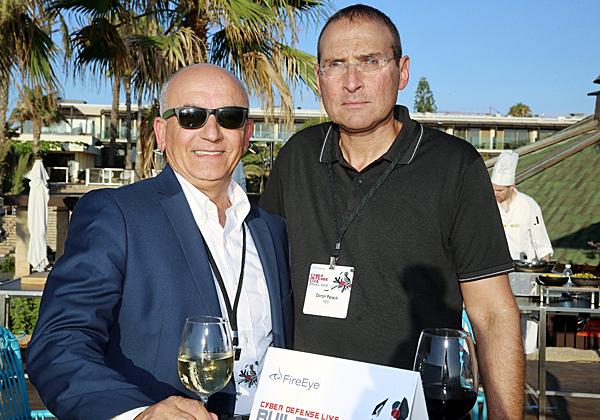 """מ/שמאל: דורון פלח, מנמ""""ר yes; ומאיר עמור, מנהל פעילות FireEye בישראל. צילום: ניב קנטור"""