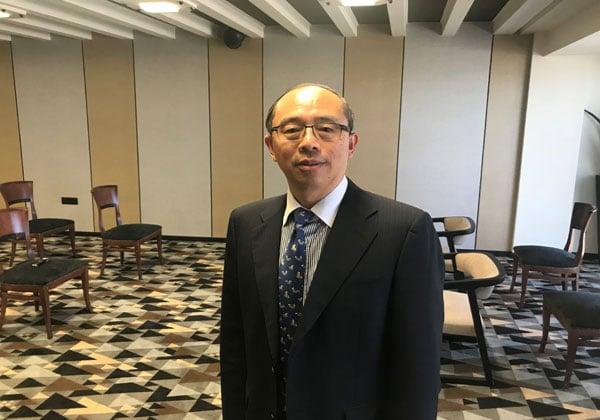 """דו יונג, מנכ""""ל הסוכנות לקידום עסקים של חבל יונאן בסין. צילום: אבי בליזובסקי"""