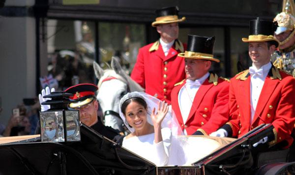 מייגן מרקל והנסיך הארי בחתונתם. צילום: BigStock