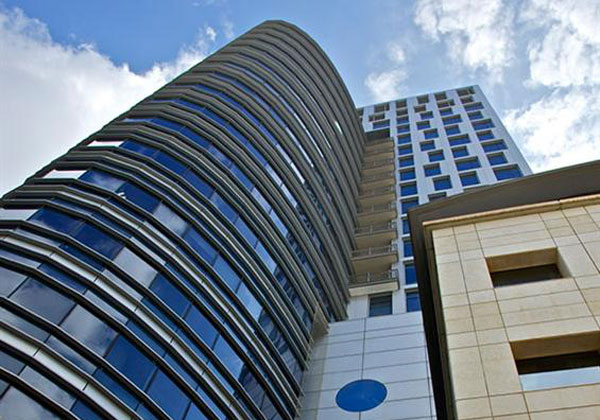 מגדל קונקורד בן 19 הקומות, שבו ממוקם המתחם של אמפרסנד. צילום: פלי הנמר