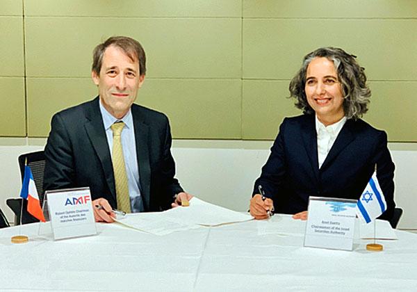"""מימין: יו""""רית רשות ניירות ערך הישראלית, ענת גואטה, ועמיתה מצרפת, רוברט אופל. צילום: דוברות הרשות"""