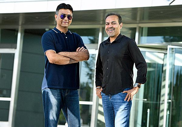 """המנכ""""לים של שתי החברות: אבינאס לקשמן מהדוויג וסאנג'יי מירצ'נדאני מקומוולט. צילום: יח""""צ"""