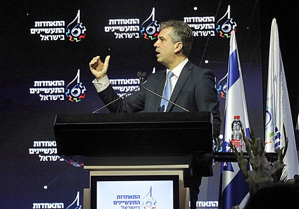 שר הכלכלה, אלי כהן, בוועידה הבוקר (ב'). צילום: סיוון פרג'