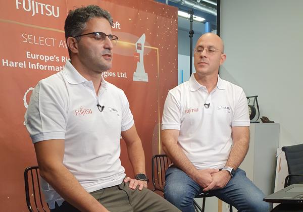"""מימין: דיוויד אזולאי, מומחה טכנולוגי לאזור EMEA, ועמית גולדברג, מנהל פריסייל ישראל בפוג'יטסו. צילום: יח""""צ"""