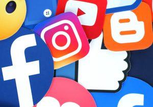 טור על שני הצדדים של מטבע המדיה החברתית. צילום: BigStock